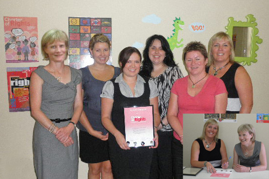 Photo of Pam Simmons with staff of key assets