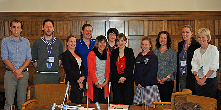 Minister posing with young people in care at Parliament House