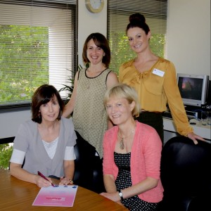 picture of Kerry Symons seated with Guardian Pam Simmons and watched by Step Out Coordinator, Stella Koukouvitakis and Senior Manager - Social Inclusion, Amber McKinnon.