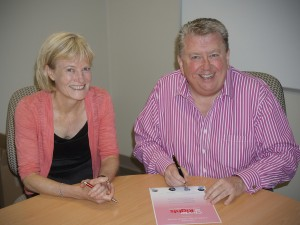 Nanny SA CEO Peter Emmerton signs the certificate of endorsement of the Charter of Rights with Guardian Pam Simmons
