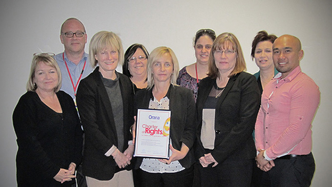 At the certificate presentation on August 12, Guardian Pam Simmons is pictured with Charter Champion Jemma Chapman holding the certificate, Acting CEO Narelle Jeffrey and some of the Orana team.
