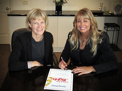 Guardian Pam Simmons is pictured signing the Charter certificate with Margaret Pyyvaara, Chief Executive Officer of Caring Choice on 25 July.