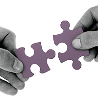 picture of hands putting together jigsaw pieces